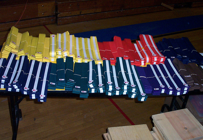 kendo belts different colors on a table