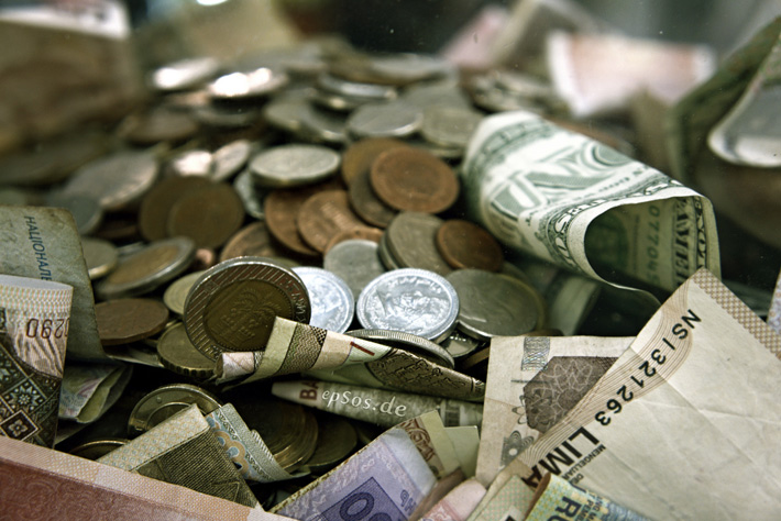 pile of money with various currencies