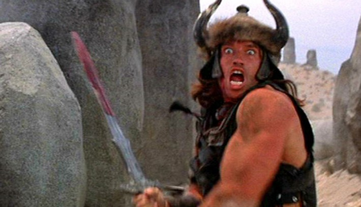 Conan the Barbarian rushing at the camera