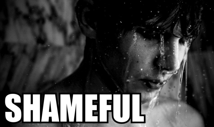 Young man in the shower with 'Shameful' overlaid