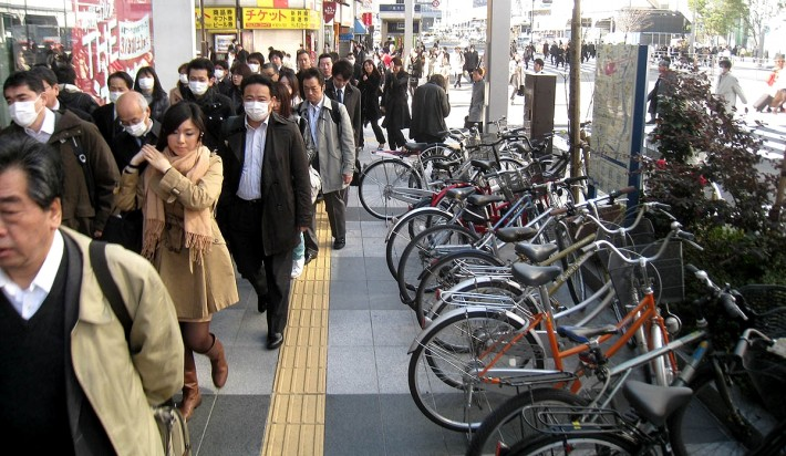 A group of Japanese pedestrians wearing surgical masks