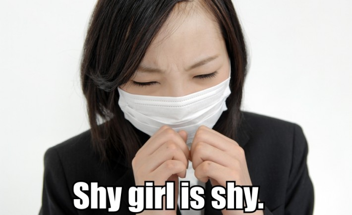 A shy Japanese girl wearing a surgical mask