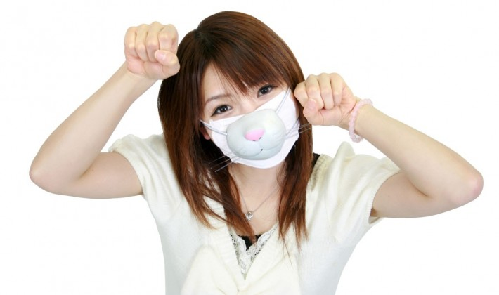 Japanese woman wearing a surgical mask with a dog design