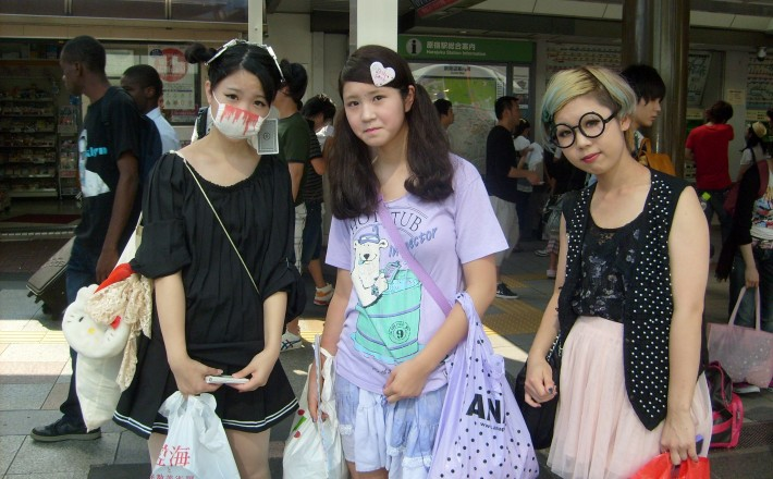a very fashionable Japanese girl wearing a surgical mask