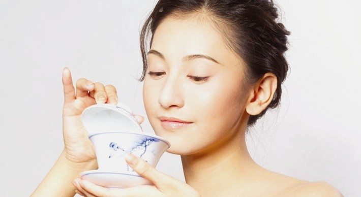 Asian woman holding a tea cup