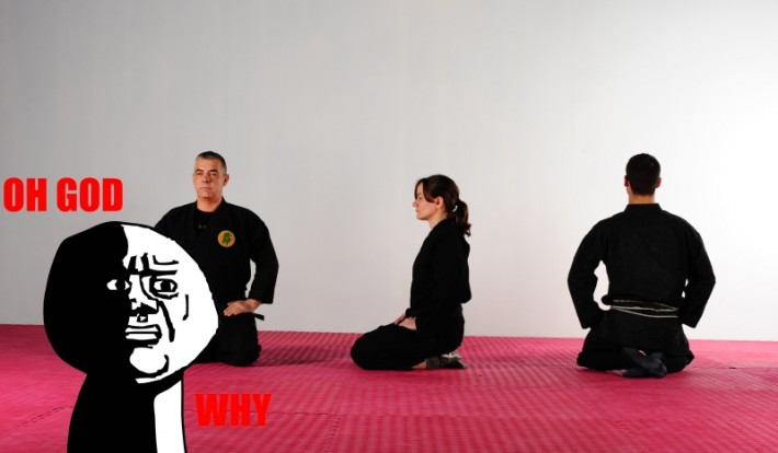 Martial artists sitting seiza with 'Oh God Why' image overlaid