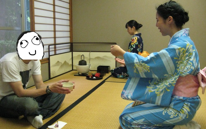 Anonymous man being served at a tea ceremony