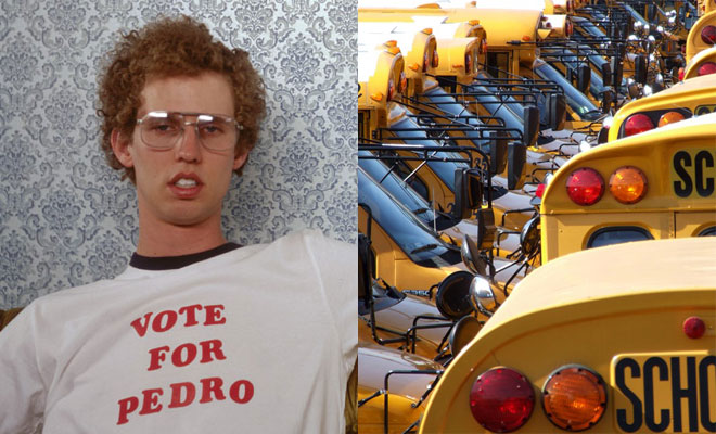 Napoleon Dynamite next to a pack of school buses