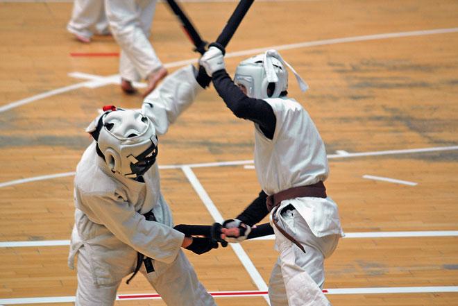 two men fighting with swords in chanbara sport