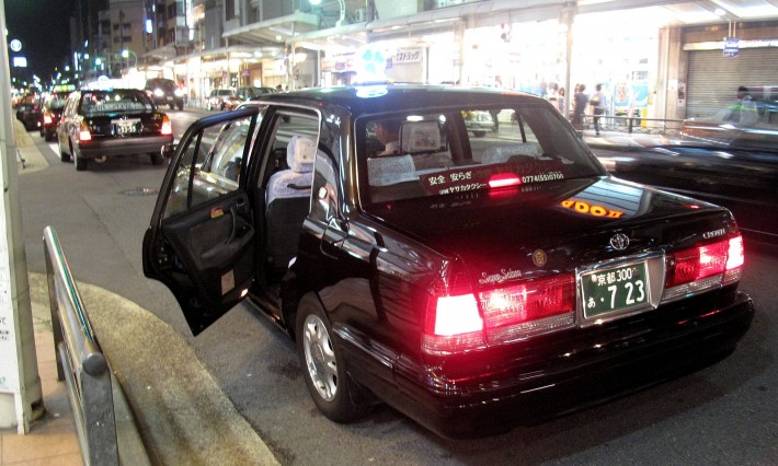 Japanese taxi with its automatic doors open