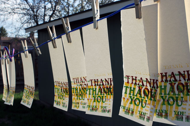 Several Thank You cards hung on clothesline
