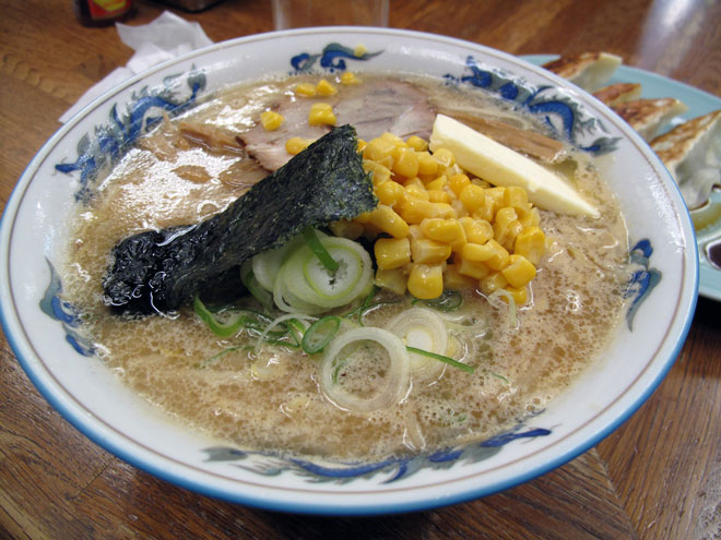 A serving of corn in a bowl of ramen