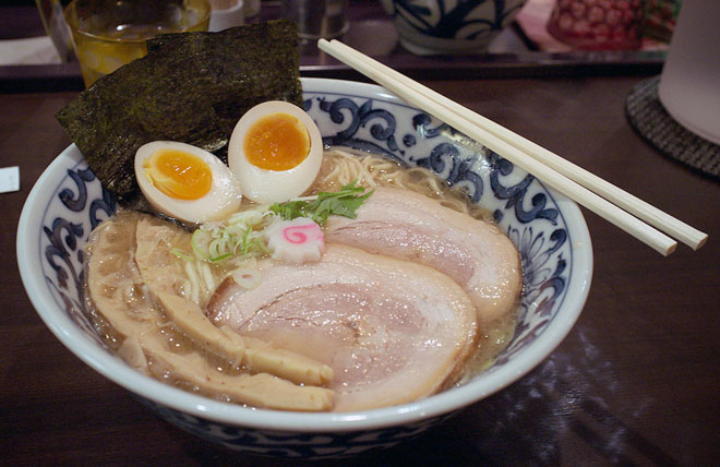Two boiled eggs in a bowl of ramen
