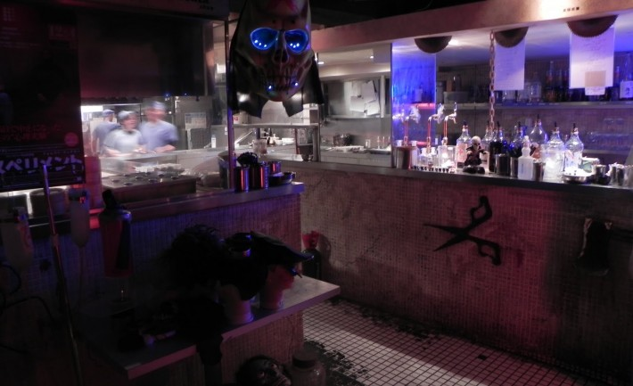 dimly-lit restaurant with blue lights and skulls