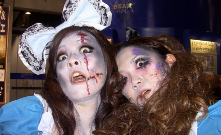 Two women in cutesy clothing made up to look like zombies
