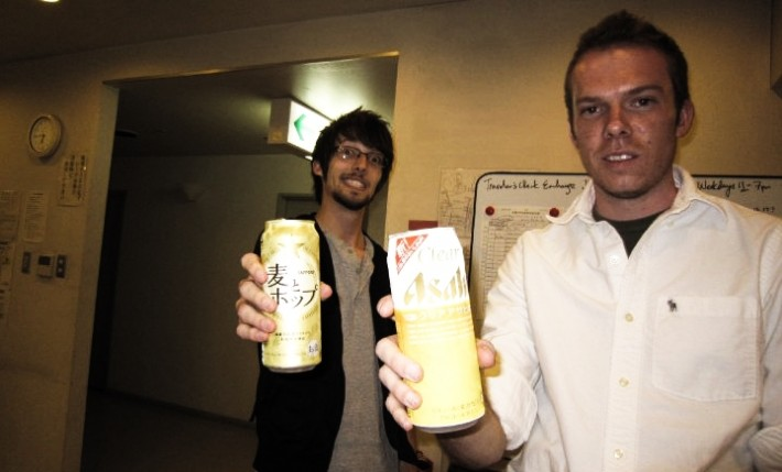 John with a friend holding a can of Japanese beer