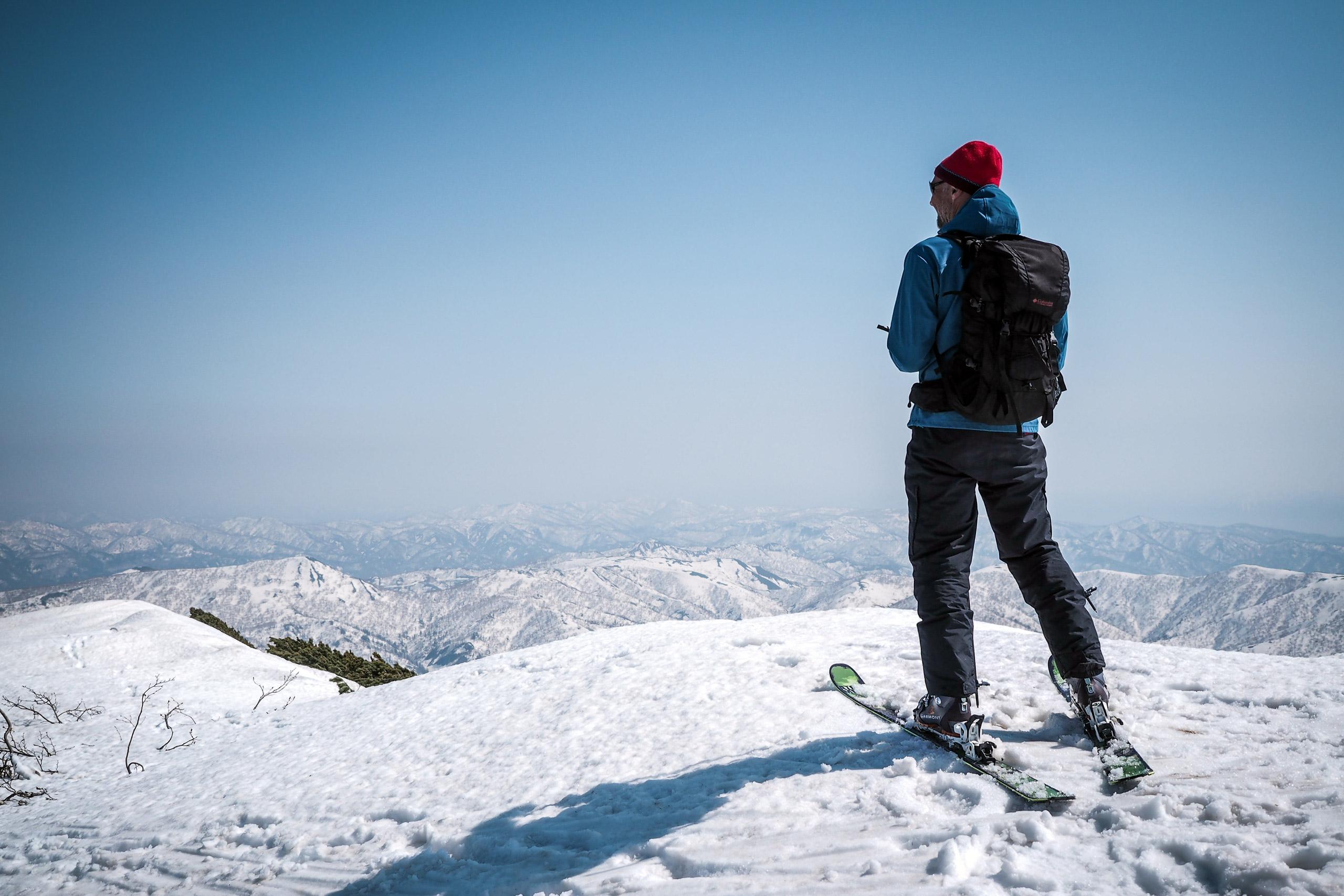 man on skis on top of mountain