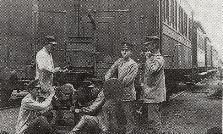 Japanese railworkers tending to a train car