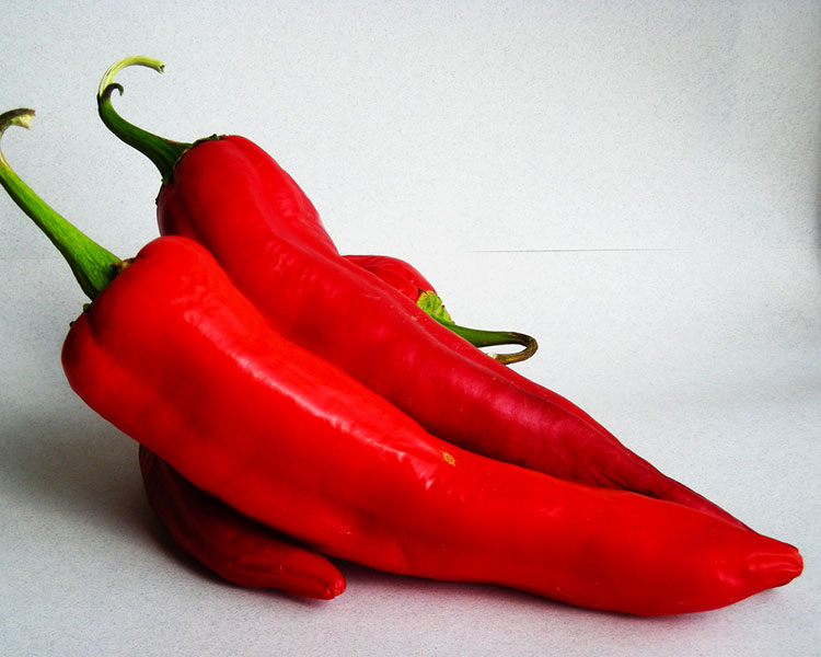 Three red bell peppers