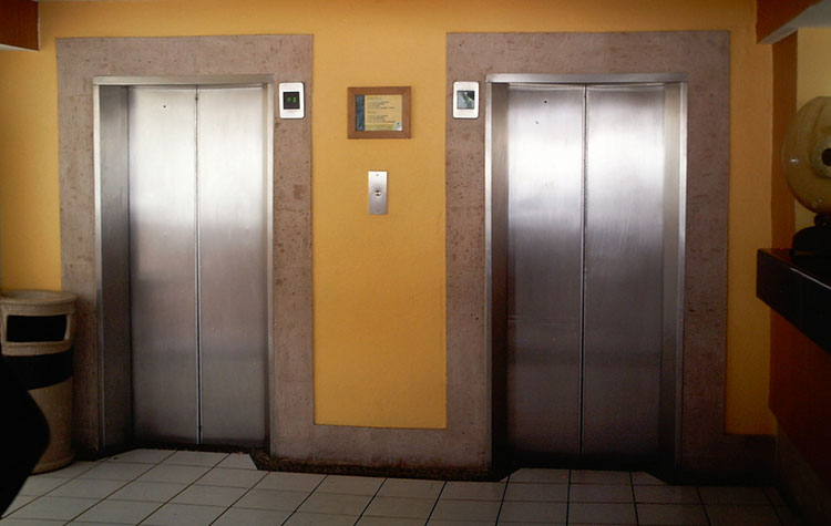 Photograph of two elevators