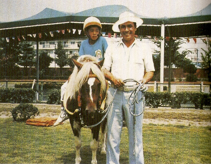 ichrio suzuki as a boy on a pony next to his father