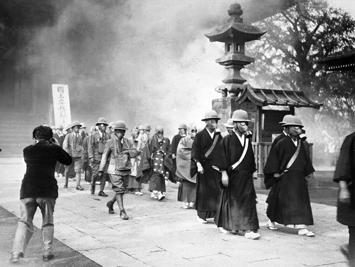 Japanese wearing gas masks