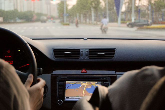 Car finding its way around Japan with GPS