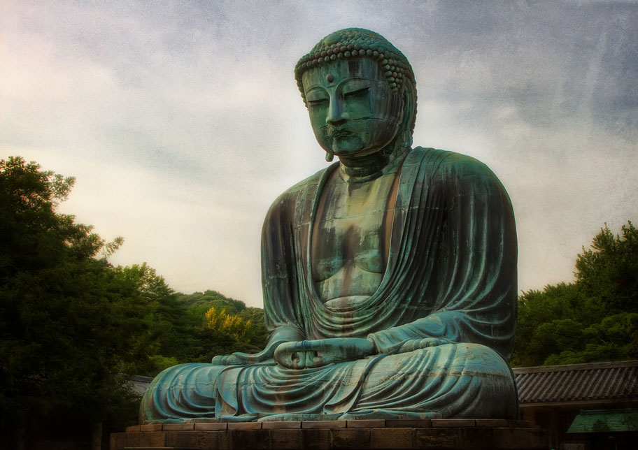 oxidized bronze daibutsu sitting buddha statue in kamakura japan