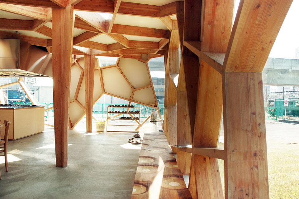 wood pavilion with geometric panels sumika pavilion by toyo ito