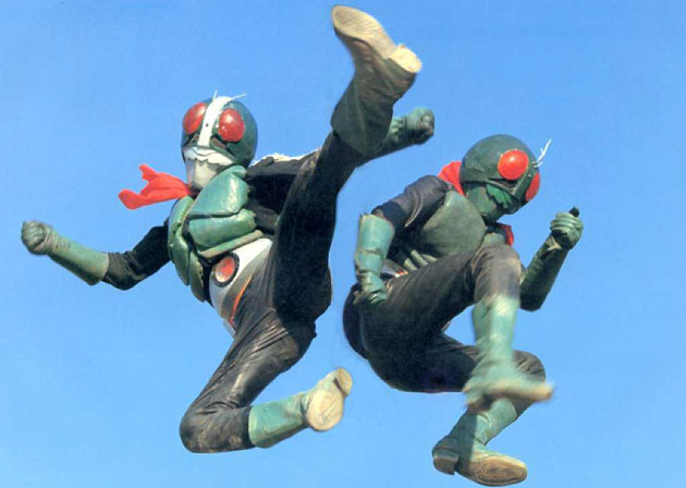 two people in costume doing jump kicks