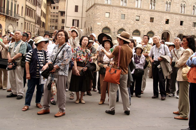 A large group of Japanese tourists in Italy
