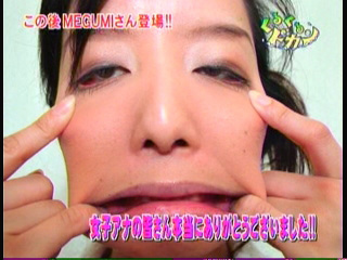 Japanese woman makes a weird face, stretching out her cheeks