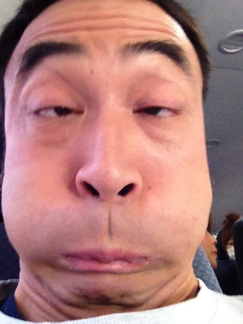 Japanese man makes a weird face while puffing out his cheeks