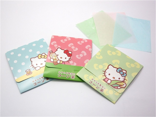 three packs of hello kitty blotting paper