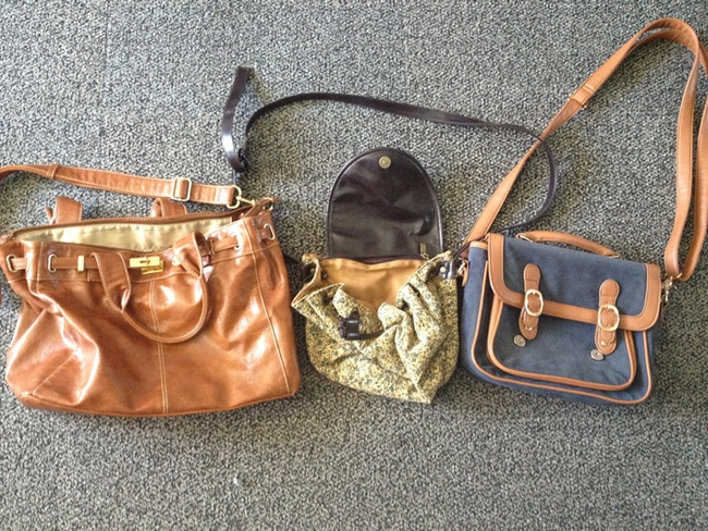 four bags womens purses on the ground