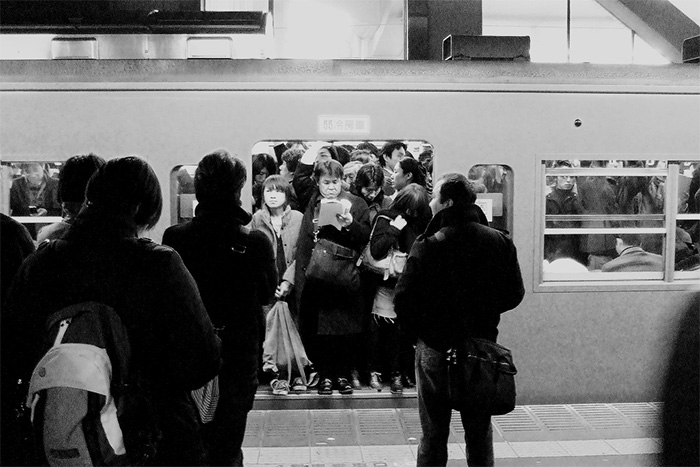 packed subway train Japan