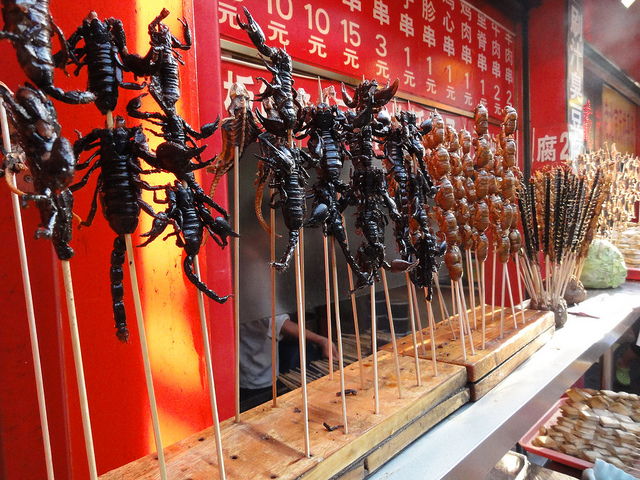 scorpions centipedes to be eaten on sticks kebabs