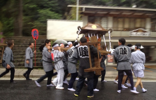 A group of men carry a mikoshi
