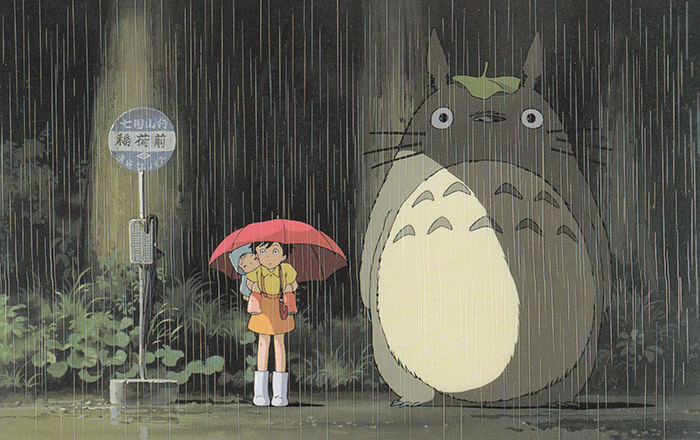 still of totoro girl standing next to creature