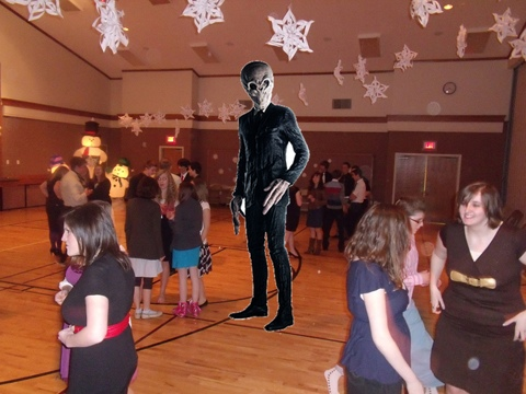 alien photoshopped onto the dance floor