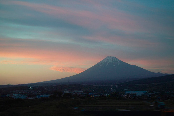Mount Fuji in the distance at dusk
