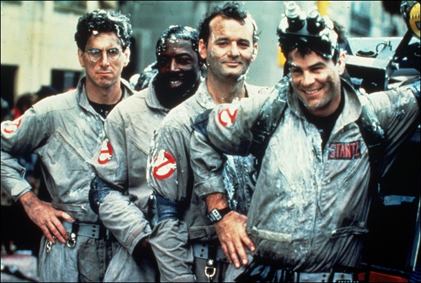 Original Ghostbusters standing together for a group shot