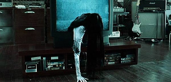 Sadako from The Ring climbing out of a tv