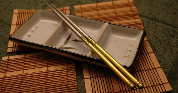 A gold-colored pair of chopsticks