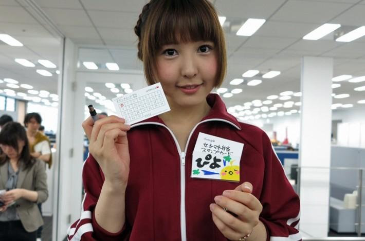 Joshi Mane Bento girl holding up a card