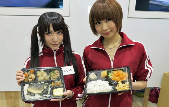 Two Joshi-Mane in red tracksuits with bento