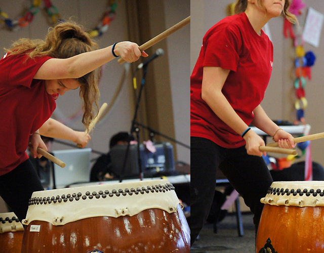 western women in the middle of taiko performance