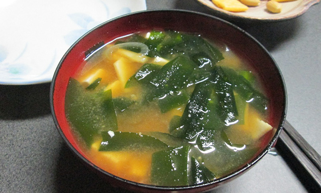 bowl of miso soup with seaweed and tofu