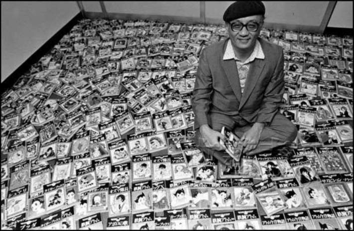 Osamu Tezuka with his artwork around him