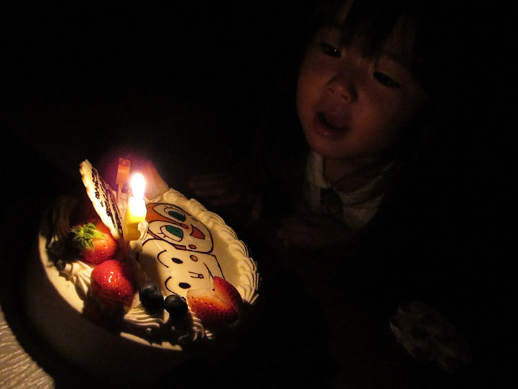 A Young Japanese Girl Prepares To Blow Out Birthday Candles
